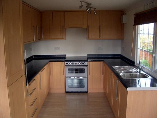 kitchen island made from solid nyatoh coated with a dark varnish